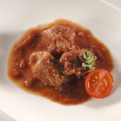 Beef cooked in red sauce in Pan